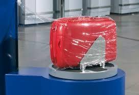 Стоимость обертывания чемодана в пленку